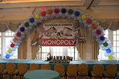 Spiral Balloon Arch in Monopoly Colors