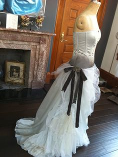 Rebecca Custom tinted silk satin corset with multilayer tulle, lace and chiffon skirt. Embellished with 100 year old charcoal velvet ribbon and 18th century cut steel shoe buckle. Only perfect for a wedding at Poe's grave!    Jill AndrewsGowns