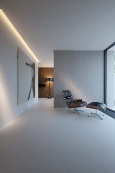 Sometimes all that's needed are some beautiful key pieces... Eames lounge chair & ottoman and Spun floor light from Flos