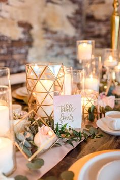 Simple wedding place setting idea - white table numbers with gold calligraphy {With This Ring}