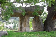 """The """"Fairy"""" Dolmen (Pierre de la Fée) - photo by rw1, via The Megalithic Portal;  in Draguignan, France;  The supporting stones are 8.2 feet high."""