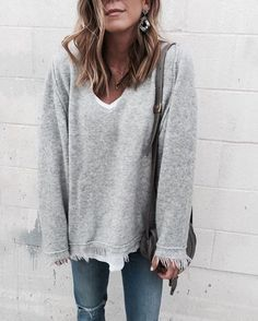 Gray sweater and jeans
