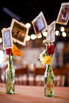 unique way to display photos as beautiful centerpieces at a rustic wedding / http://www.deerpearlflowers.com/wedding-photo-display-ideas/