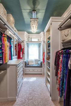 Pretty closet or wardrobe for master bedroom - teal ceiling and chandelier. I so wish I could have this!