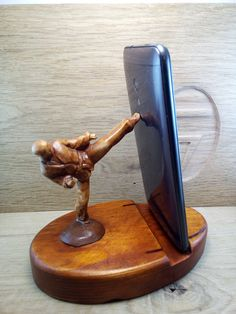 This stylish phone stand was meticulously crafted just for your device! Great detailing and unique design make the piece worth your attention. Naturally sturdy and durable due to a high quality of wood it is made of, the stand will serve you for a long time. It will not only house your devices, but also become a great decorative piece for your home or office. Karate is a timeless classic and Karate-themed items will enhance the interior and make a grand contribution to your home or office…