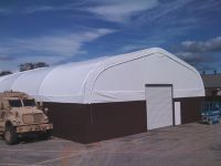 Shelter Structures recently completed a much sought after hybrid building. Designed at the request of the 75th Ranger Regiment at Ft. Benning, GA, this building includes a metal hardside for added durability, and industrial composite flooring, extending the life of an old asphalt pad. Our standard 20oz translucent PVC fabric building roofing provides natural light, and this hybrid fabric structure building can be erected anywhere.