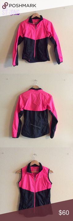 Women's convertible jacket By Nike. Neon pink and black lightweight zip front jacket with detachable sleeves in excellent condition. Two front zip pockets & one rear zip pocket. DWR (durable, water-repellent) coating & reflectorized zip front & back . Vented back with concealed perforations for breathability. Drop back hem and mock neck enhance coverage. Stretch cuffs and hem for a fit that stays in place. Drawcord at waist for a custom fit. Mesh pockets offer breathable storage. Fabric…