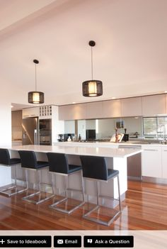 Contemporary, Laminex 'Moleskin' doors, 'Luna White' Quartz bench tops, concealed pantry with loads of storage. Counter stools, feature island panel in Laminex 'Sorrel'. Covered patio with outdoor kitchen, patio, pendant lights, latest appliances, glass splashback. Wine rack. - houzz.com