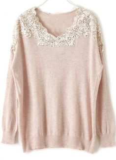 pink lace sweater - mine is a light pinkish ivory. Pretty with black pants in the winter and lightweight enough to wear in the spring with white jeans.