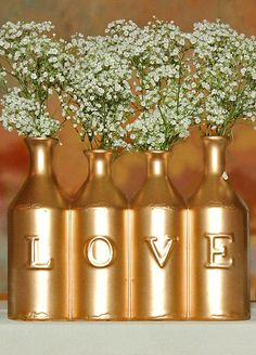 We love these! You can easily spray paint an assortment of bottles and use them for decoration.<3