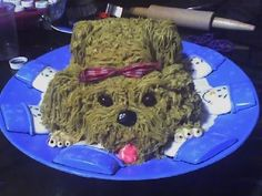 "3 D dog cake tutorial.  Need two 9"" rounds, a grass icing tip, and a gazillion pounds of icing.  Looks great though."
