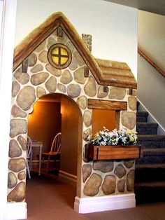 playhouse under the stairs | storybook cottage mural for kids under stairs playhouse