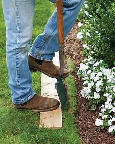 A humble plank of wood in any size provides a terrific alternative to the string-and-spade method of edging a lawn.