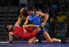 Wrestling Freestyle - 65kg Men Soslan Ramonov (blue) of the Russian Federation and Toghrul Asgarov of Azerbaijan compete in the Men's Freestyle 65kg Gold match on Day 16 of the Rio 2016 Olympic Games at Carioca Arena 2 on August 21, 2016 in Rio de Janeiro, Brazil.