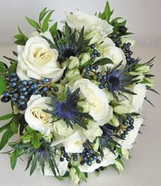 White flowers with a touch of Blue thistle bouquet
