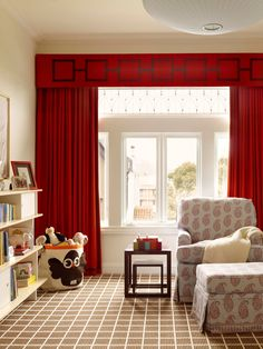 Vibrant red curtains and a formal valance feel sophisticated but not overdone in the nursery. - Traditional Home ® / Photo: Matthew Millman / Design: Palmer Weiss