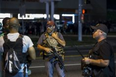 Of course they can carry guns & not get killed!!!  Surprised?  You shouldn't be.  Aug. 11, 2015 Members of the Oath Keepers stand with their weapons during protests in Ferguson, Mo. - Lucas Jackson/Reuters