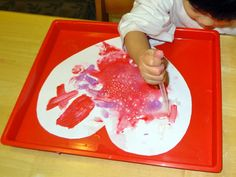 Paint with 1 TBS of paint with 3 TBS of baking soda.  Use eye droppers and add vinegar to see the fizz.