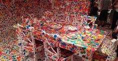 Obliteration Room uses kids and thousands of stickers to go from plain to colourful. Japanese artist Yayoi Kusama started with a room painted entirely in pristine white. Everything from the walls, floor, and ceiling to the table, chairs, and piano were perfectly white. She then unleashed the smallest visitors to the Gallery of Modern Art at the Queensland Art Gallery, armed with thousand of colourful dot stickers.