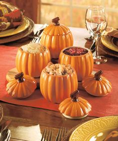 Fill your dining room with the color of this decorative and functional Set of 4 Pumpkin Side Dishes. Great for individual servings of stuffing, mashed potatoes, green bean casserole and more, these pumpkin-shaped dishes also have decorative handled l