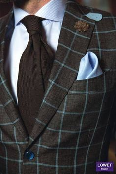 Very snotty!! Love the light blue windowpane in the jacket.