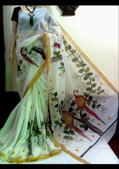 An attractive Kerala Kasavu Pure Cotton with Hand Painted Work Saree