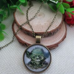 NEW STAR WARS YODA ANTIQUE BRONZE GLASS NECKLACE Star Wars yoda antique bronze dome glass pendant necklace.  NO TRADES OR QUESTION COMMENTS FROM NON SERIOUS BUYERS DO NOT LOWBALL PRICE IS FIRM Jewelry Necklaces