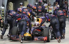 Red Bull Formula One driver Daniel Ricciardo of Australia has his car pushed back to the garage during the Malaysian F1 Grand Prix at Sepang International Circuit outside Kuala Lumpur, March 30, 2014. Ricciardo was handed a 10 place grid penalty for next week's Bahrain Grand Prix after Formula One stewards ruled he had left the pits in an unsafe manner in Sunday's Malaysian race.