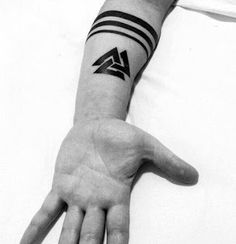 What does valknut tattoo mean? We have valknut tattoo ideas, designs, symbolism and we explain the meaning behind the tattoo. Small Tattoos Men, Wrist Tattoos For Guys, Trendy Tattoos, Meaningful Tattoos For Men, Tatto For Men, Band Tattoos For Men, Mens Wrist Tattoos, Tatoos Men, Cool Tattoos For Guys