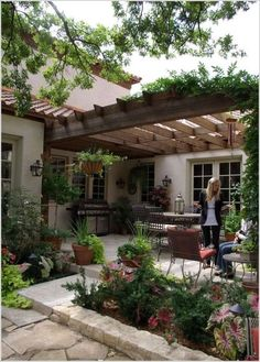 I love this pulled together look and romantic pergola! Thinking of buying a pergola? Learn the essential facts about pergola kits and designs here. Backyard Patio Designs, Pergola Designs, Pergola Patio, Backyard Landscaping, Pergola Kits, Pergola Ideas, Landscaping Design, Wooden Pergola, Wooden Trellis
