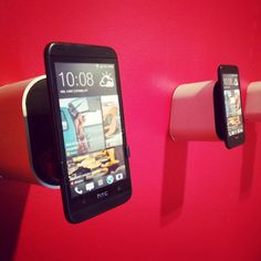 The #display4 mounted on a wall #securing a #smartphone with #vise4