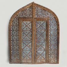 Antique Indian door from Rajasthan.  Arched top Mogul design with Iron strap details brass medallions and craved teak frame.  One of a kind find. www.mixfurniture.com Item# IMP10SP146 #mixfurniture #olddoor #antiquedoor #indian #india #indiandoor #rajasthan #architecture