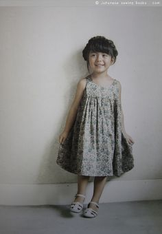 From a Sunny Spot japanese pattern book- little girls clothes to sew... Loose sun dress with gathered skirt in floral cotton...
