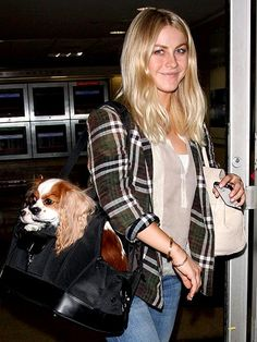 Julianne Hough keeps company with Cavalier King Charles spaniels Lexi and Harley upon arriving at Los Angeles International Airport. More star pet photos: http://www.peoplepets.com/people/pets/gallery/0,,20591568,00.html#21155527