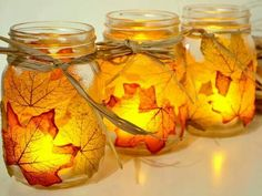 Leaves on mason jars with candles