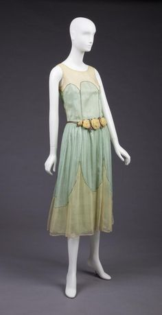 1923-24 Pale Yellow and Mint Green Silk Georgette Over Mint Green Silk Satin Dress. Machine Wrap Stitdh Attaching Yellow To Green In Large Scalloping Pattern and Along Princess Seams. 3 Yellow Georgette Roses At Slightly Dropped Waist.  Goldstein Museum