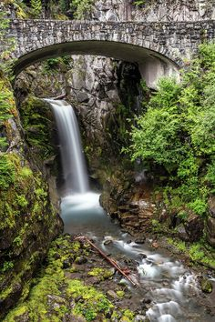 Christine Falls is a waterfall on Van Trump Creek in Pierce County, Mount Rainier National Park, Washington. The falls are 69 feet high but we only see the lower 37 foot part. One of the main feature is a bridge spanning the lower drop. Mount Rainier National Park, Great Shots, Voss Norway, Washington, National Parks, Instagram Images, Stock Photos, Adventure, Caves