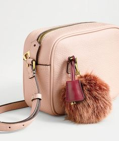 A truly one-of-a-kind present from J.Crew… that still takes care of half your shopping list. Start customizing their Signet or Rider bag with faux-fur pom-poms (!), leather tassels and more at jcrew.com.