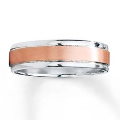 Handsome just like he is, this two-tone men's wedding band complements him perfectly.