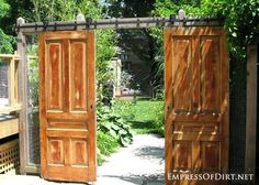 Old doors instead of garden gates - gallery of ideas. This was a favourite idea I saw on a garden tour. Using barn door hardware, they hung two old doors to mark the entrance to the garden. This style allows a nice wide entry point for getting equipment in and out, and the wood definitely adds old charm to an otherwise very modern looking garden.