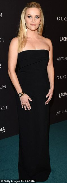 Little black delight: The long Gucci gown showcased her slender but toned physique to the full