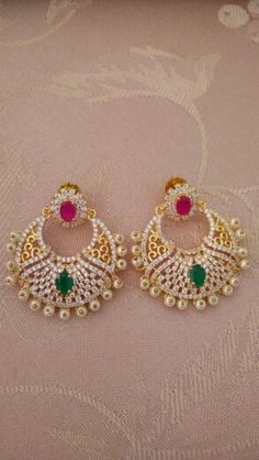 #Ruby and #Emerald studded Gold plated American Diamonds #Chandballis / #Danglers ...and You can buy them at ...Ansvet