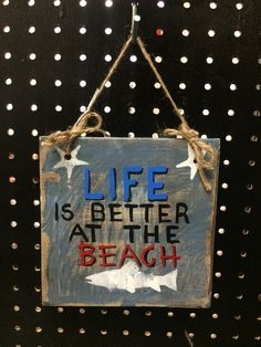 """""""Life is Better at the Beach"""" sign."""