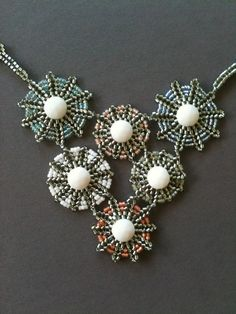 White & Silver snowflake necklace by Jeka Lambert.  Seed bead woven.  1920s vintage nailhead beads, seed beads, crystal pearl.
