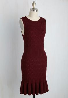 Just when you thought finding the perfect sweater dress is only a dream, this burgundy sheath appears right before your eyes! Textured with a diamond pattern, ribbed at the waistline, and made all the more flirty with a ruffled hem, this sleeveless number is a wardrobe pinnacle you can't pass up.