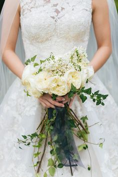 bouquet consisted of garden roses accented with white lilac, and the greenery was different kinds of ivy, jasmine, and maidenhair fern. The bridesmaids held bouquets of baby's breaths