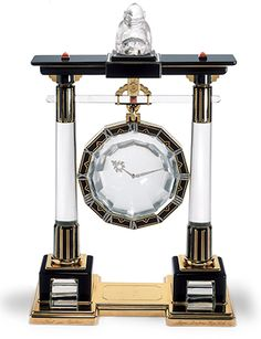 Cartier Collection - Maison Cartier- LARGE PORTIQUE MYSTERY CLOCK CARTIER PARIS, 1923 Yellow gold, platinum, rock crystal, rose-cut diamonds, onyx, coral cabochons, black enamel. Sold to Mrs. H.F. McCormick, Ganna Walska (1887-1984) the opera singer of Polish origin.  Like Daisy Fellowes and Mona Bismarck, Walska was one of the select group of fashion icons of her day. With unerring taste, she assembled a remarkable collection of jewelry, showing a marked preference for Cartier.