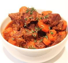 Herbed beef stew. Delicious and spicy cubed beef with vegetables cooked in slow cooker.