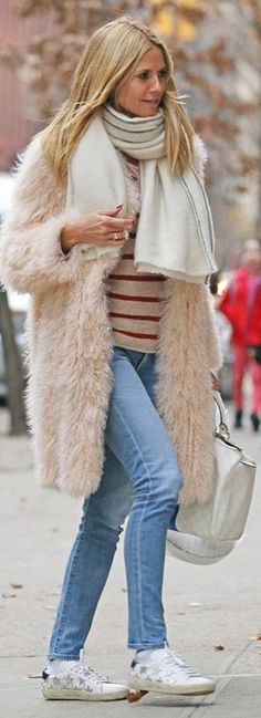Who made Heidi Klum's white star sneakers, tan coat, and stripe handbag?