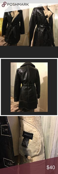 """""""Guess"""" Shiny Black Faux Fur-lined Coat (MEDIUM) This coat is adorable, and one of my favorites!  Size is MEDIUM. The outer shell is 65% Wool and 35% PU (poly) leather. What's awesome about this material is for the most part WATERPROOF and extremely easy to clean...the body fur is 90% Polyester and 10% Acrylic, and SUPER soft. Length comes to mid-thigh  (I'm 5'6""""). Small flaws: 1) 3 slightly loose buttons, easy to secure (see pic); and 2) slight blue/grey tint on inner fur; possibly can be…"""